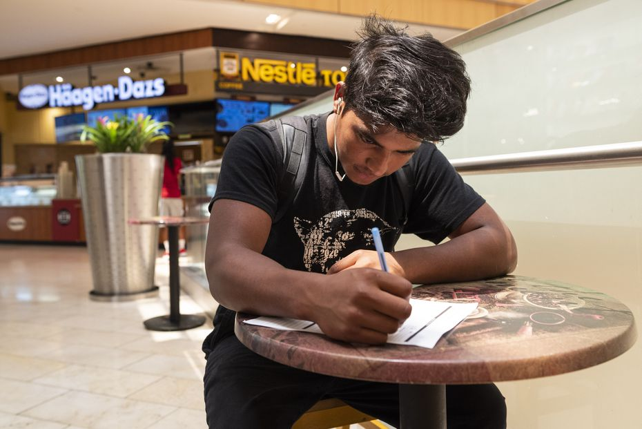 Alonzo Flores, 19, completes a job application for Nestle Toll House Cookies at Galleria Dallas, on Tuesday, Aug. 10, 2021 in Dallas. Flores is looking for a part-time job while attending school.