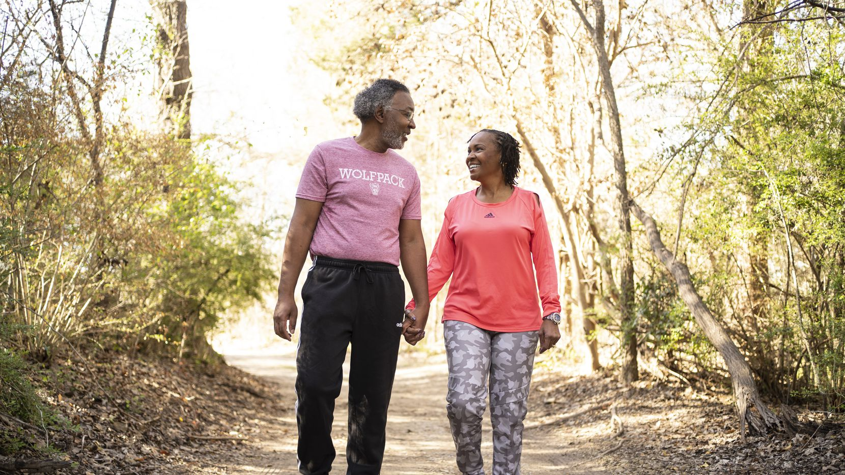 "During a recent walk, Sheron Patterson was looking at some bamboo killed by the recent freeze, but then saw a redbud bloom overhead. ""You had to look up to see it, and I always look up,"" she says. ""You have to have hope."" She's pictured with her husband, Robert."