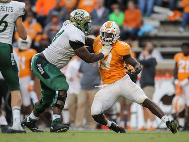 FILE - Charlotte offensive tackle Nate Davis (64) blocks Tennessee defensive end Darrell Taylor (19) during a game at Neyland Stadium on Nov. 3, 2018, in Knoxville, Tenn. (Photo by Donald Page/Getty Images)