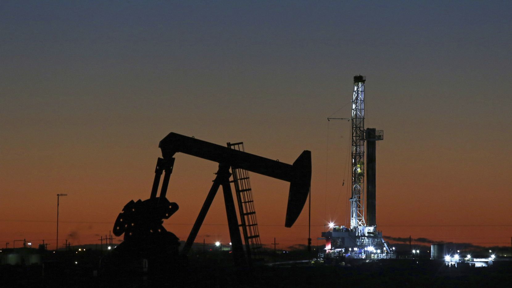 An oil rig and pump jack in Midland. Irving-based Pioneer Natural Resources has a deal to buy Fort Worth-based DoublePoint Energy.