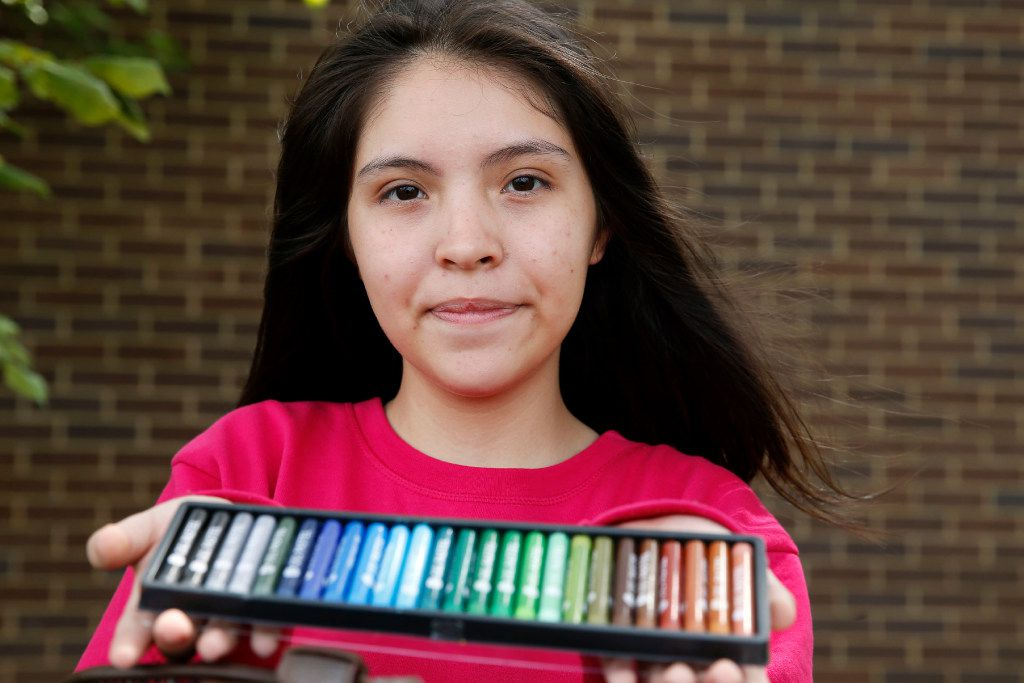 Annette Quintana, 14, of La Porte, brought her art supplies with her as she took shelter at the Walnut Hill Recreation Center in Dallas.  (Vernon Bryant/Staff Photographer)