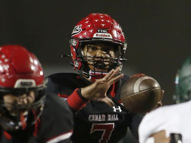Cedar Hill quarterback Kaidon Salter (7) takes the snap on a drive during the first half of a game against DeSoto. The two teams played their District 11-6A game at Longhorn Stadium in Cedar Hill on Nov. 6, 2020.