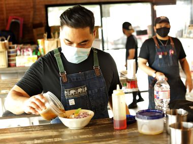 Donny Sirisavath, left, prepares khao poon at Khao Noodle Shop in Dallas in June 2020. A year after being named one of the best new restaurants in the nation, life has changed drastically for Sirisavath.
