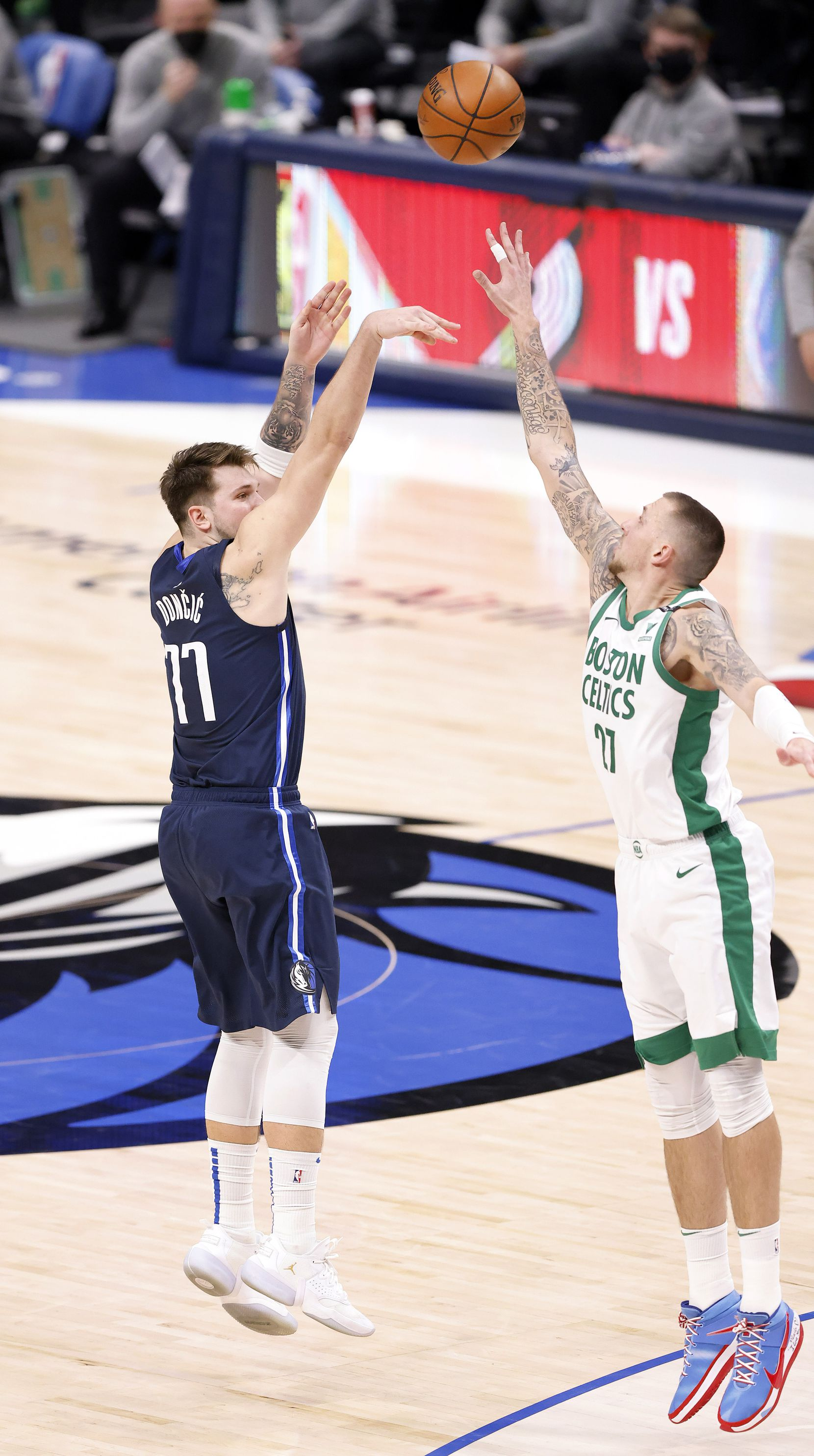 Dallas Mavericks guard Luka Doncic (77) made a late fourth quarter three-point shot over Boston Celtics center Daniel Theis (27) at the American Airlines Center in Dallas, Tuesday, February 23, 2021. (Tom Fox/The Dallas Morning News)