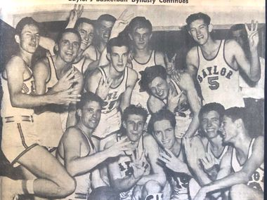 The 1950 Baylor men's basketball team celebrates after winning its third consecutive Southwest Conference title.
