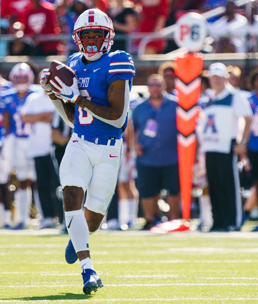 FILE - SMU wide receiver Reggie Roberson Jr. (8) hauls in a 75-yard touchdown pass from quarterback Shane Buechele during the first half of a game against Temple at Ford Stadium on Saturday, Oct. 19, 2019, in Dallas.