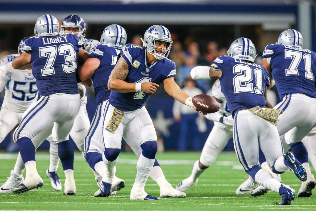 Dallas Cowboys quarterback Dak Prescott (4) hands the ball to running back Ezekiel Elliott (21) during the first half of an NFL game between Dallas Cowboys and Tennessee Titans at AT&T Stadium in Arlington, Texas on Monday, November 5, 2018. (Shaban Athuman/The Dallas Morning News)