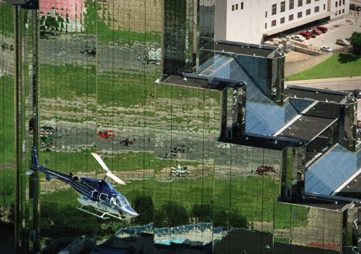 Boeing officials took a helicopter tour of Dallas in 2001, passing by the Hyatt Regency Dallas at Reunion near downtown, before deciding to move to Chicago instead. (The Dallas Morning News/File)