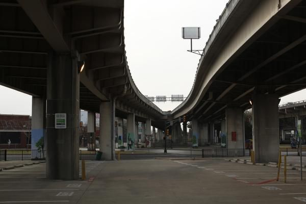 Underneath the elevated Interstate 345, which separates downtown Dallas and Deep Ellum.