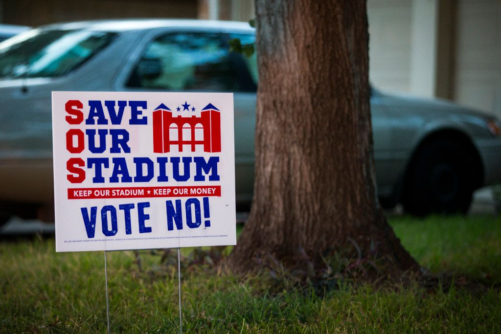 Yard signs express opposition to a proposal to build a $1 billion retractable-roof stadium for the Texas Rangers.