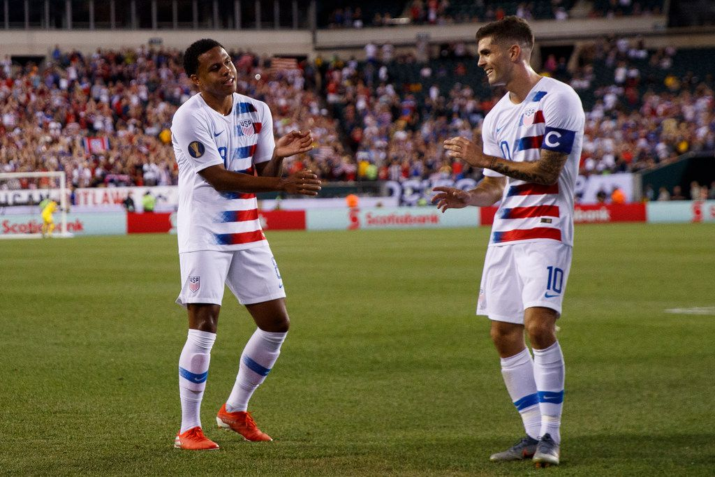 United States' Weston Mckennie, left, and Christian Pulisic celebrate after Mckennie's goal during the first half of a CONCACAF Gold Cup soccer match against Curacao, Sunday, June 30, 2019, in Philadelphia. The United States won 1-0. (AP Photo/Matt Slocum)