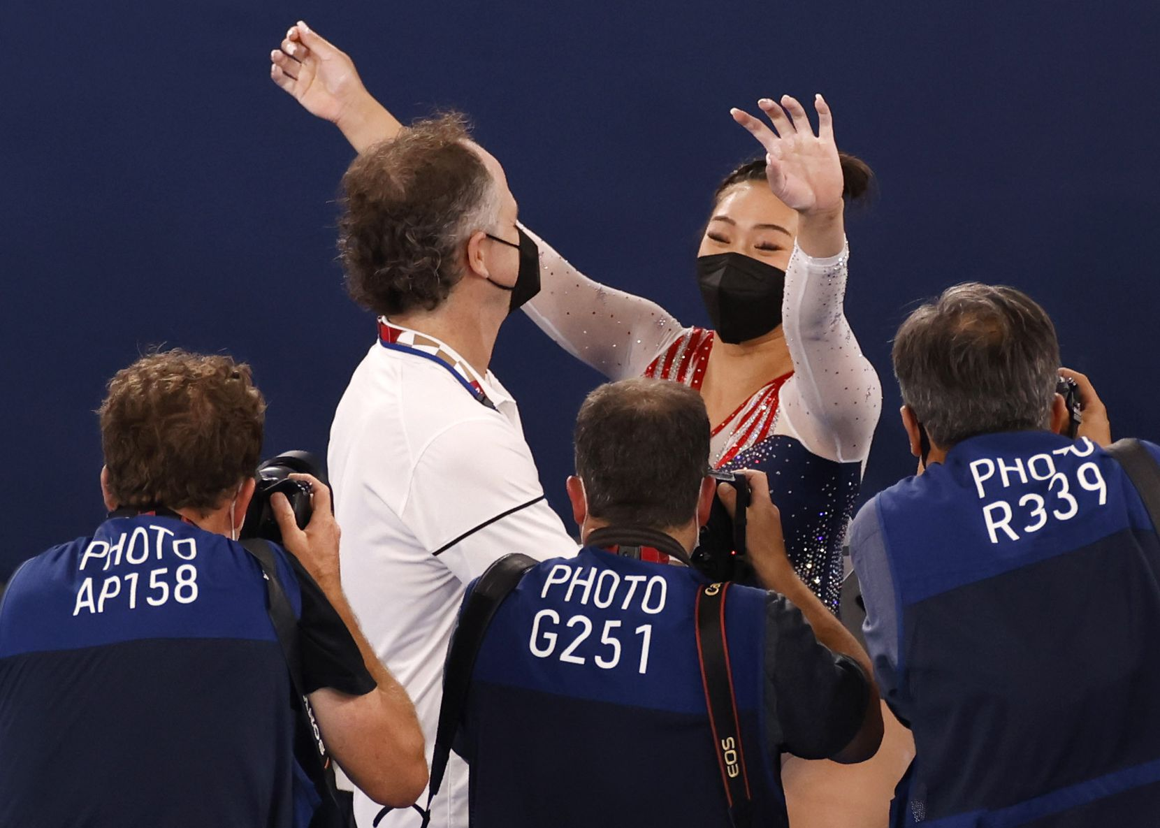USA's Sunisa Lee hugs her coach Jeff Graba after winning gold in the women's all-around final at the postponed 2020 Tokyo Olympics at Ariake Gymnastics Centre, on Thursday, July 29, 2021, in Tokyo, Japan. (Vernon Bryant/The Dallas Morning News)