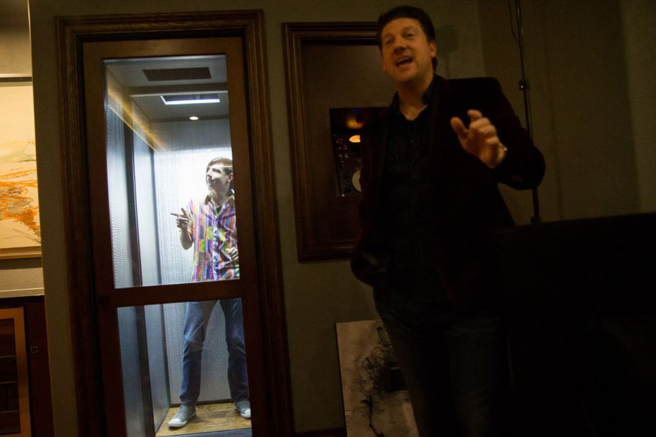"""Randy Pitchford, left, and his father Randy Pitchford, demonstrate the """"Dematerialization Chamber"""" at their residence on May 29, 2016 in Frisco, Texas."""