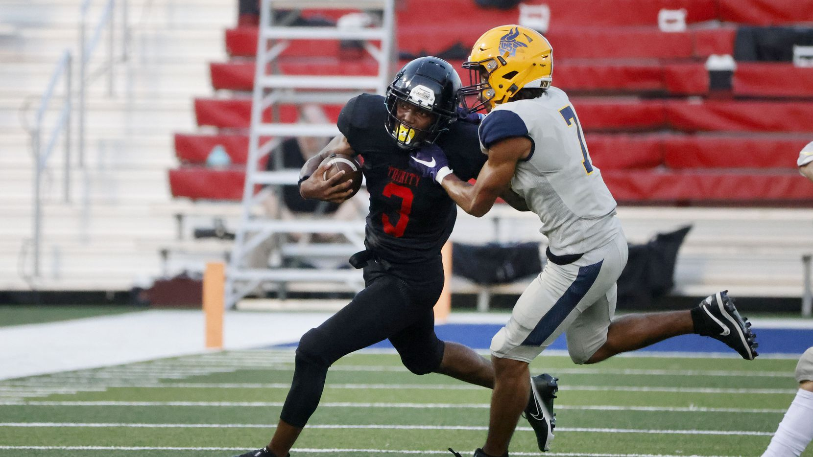 Euless Trinity running back Garry Maddox (3) tries to get out the grasp of Arlington Lamar defender Lonnell Cunningham during the first half of their high school football game in Bedford, Texas on Aug. 26, 2021. (Michael Ainsworth/Special Contributor)