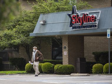 A man wearing a masks exits the Skyline Nursing Center in Oak Cliff on March 30, 2020 in Dallas. As of April 13, up to one in three of all known coronavirus-related deaths in Texas occurred in a long-term care facility. (Juan Figueroa/ The Dallas Morning News)