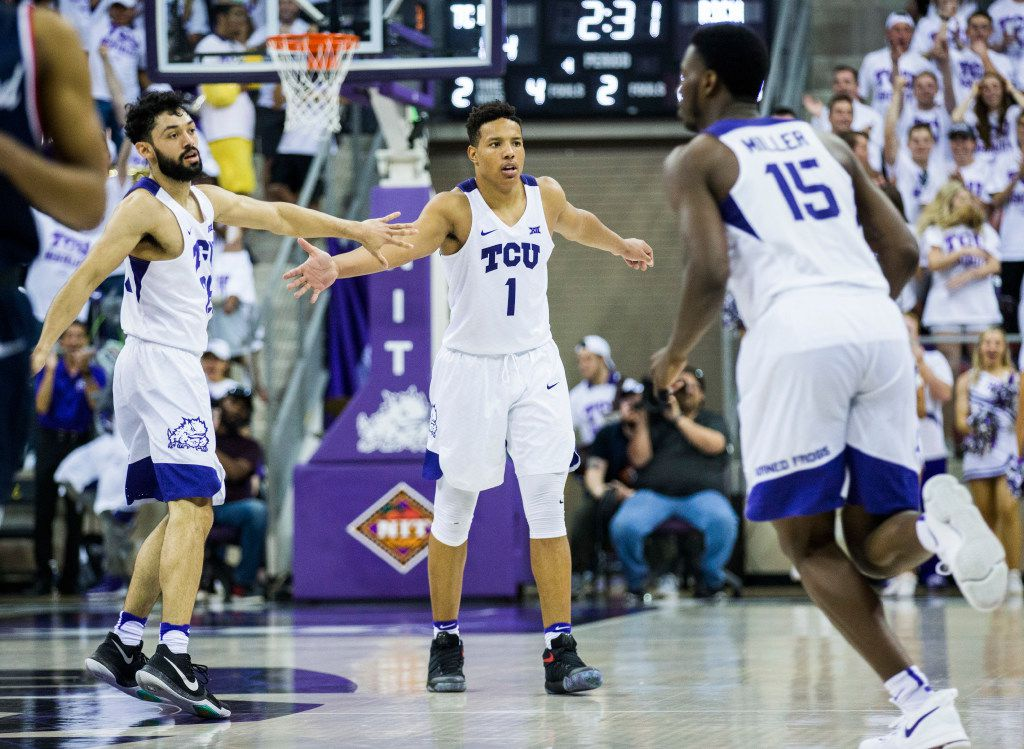 TCU Horned Frogs guard Desmond Bane (1) gets a high-five from guard Alex Robinson (25) after he scored during the second half of an NIT quarterfinal game between TCU and University of Richmond on Tuesday, March 21, 2017 at the Ed & Rae Schollmaier Arena in Fort Worth. TCU won the game 86-68, and will continue to the next round of the tournament in New York City. (Ashley Landis/The Dallas Morning News)