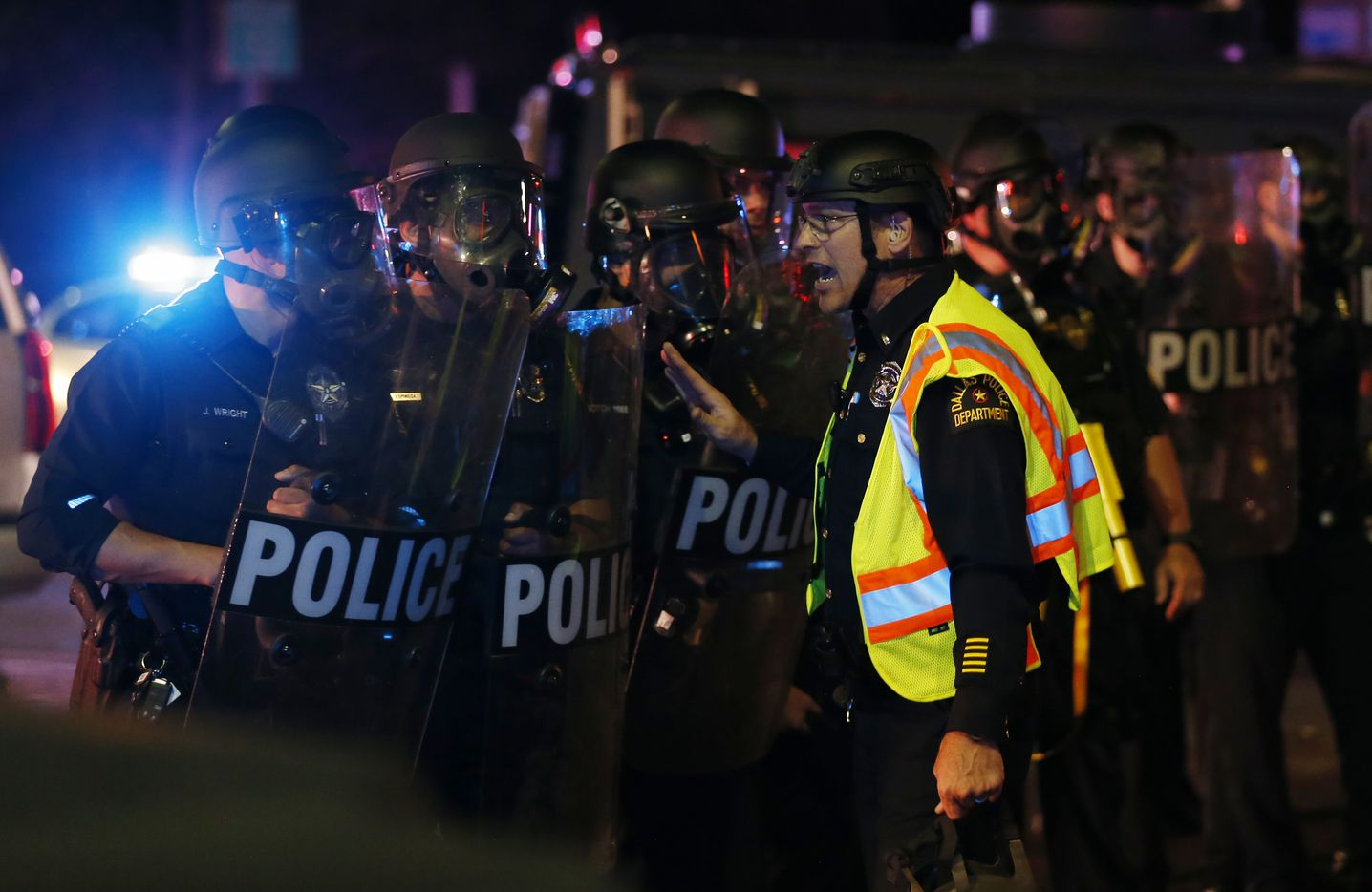 Dallas police work on controlling the protesters along the intersection of Young Street and Griffin in downtown Dallas, on Friday, May 29, 2020. George Floyd died in police custody in Minneapolis on May 25.