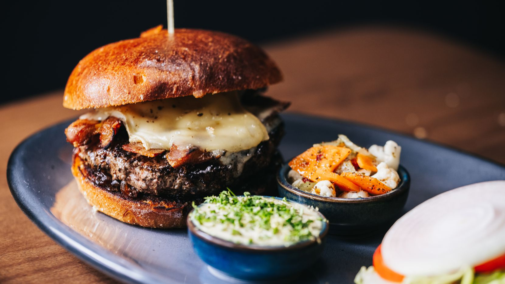 Ounce, a restaurant in downtown Dallas' AT&T Discovery District, will sell a burger created by chef Brian Zenner. Ounce is expected to open Dec. 16, 2020.
