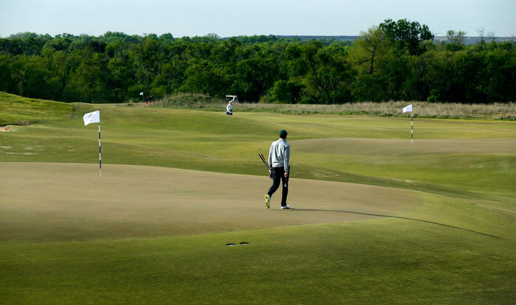 A golfer walks across the 15th green as the 5th green is seen in the background at the new Trinity Forest Golf Club in Dallas Monday, April 23, 2018. The course is the new home of the Byron Nelson golf tournament. (Tom Fox/The Dallas Morning News)