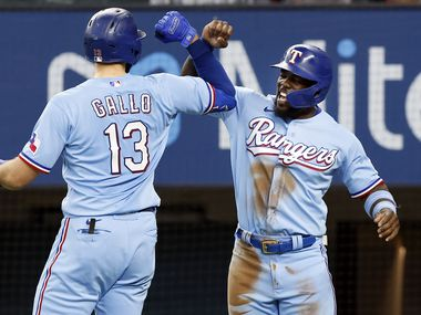 Texas Rangers batter Joey Gallo (13) is congratulated by Adolis Garcia after connected on a two-run homer to left field in the first inning against the Kansas City Royals at Globe Life Field in Arlington, Texas, Friday, June 27, 2021.