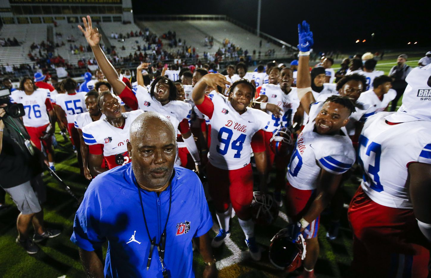 Duncanville celebrates a 42-21 win over DeSoto after a high school football game at DeSoto High School, Friday, September 17, 2021. It was Duncanville head coach Reginald Samples', lower right, 300th career win. (Brandon Wade/Special Contributor)