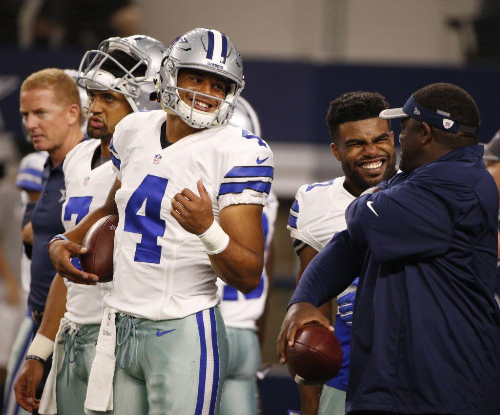 Dallas Cowboys quarterback Dak Prescott (4) jokes around before their game against the Houston Texans at AT&T Stadium in Arlington, Texas Sept. 1, 2016.  (Nathan Hunsinger/The Dallas Morning News)
