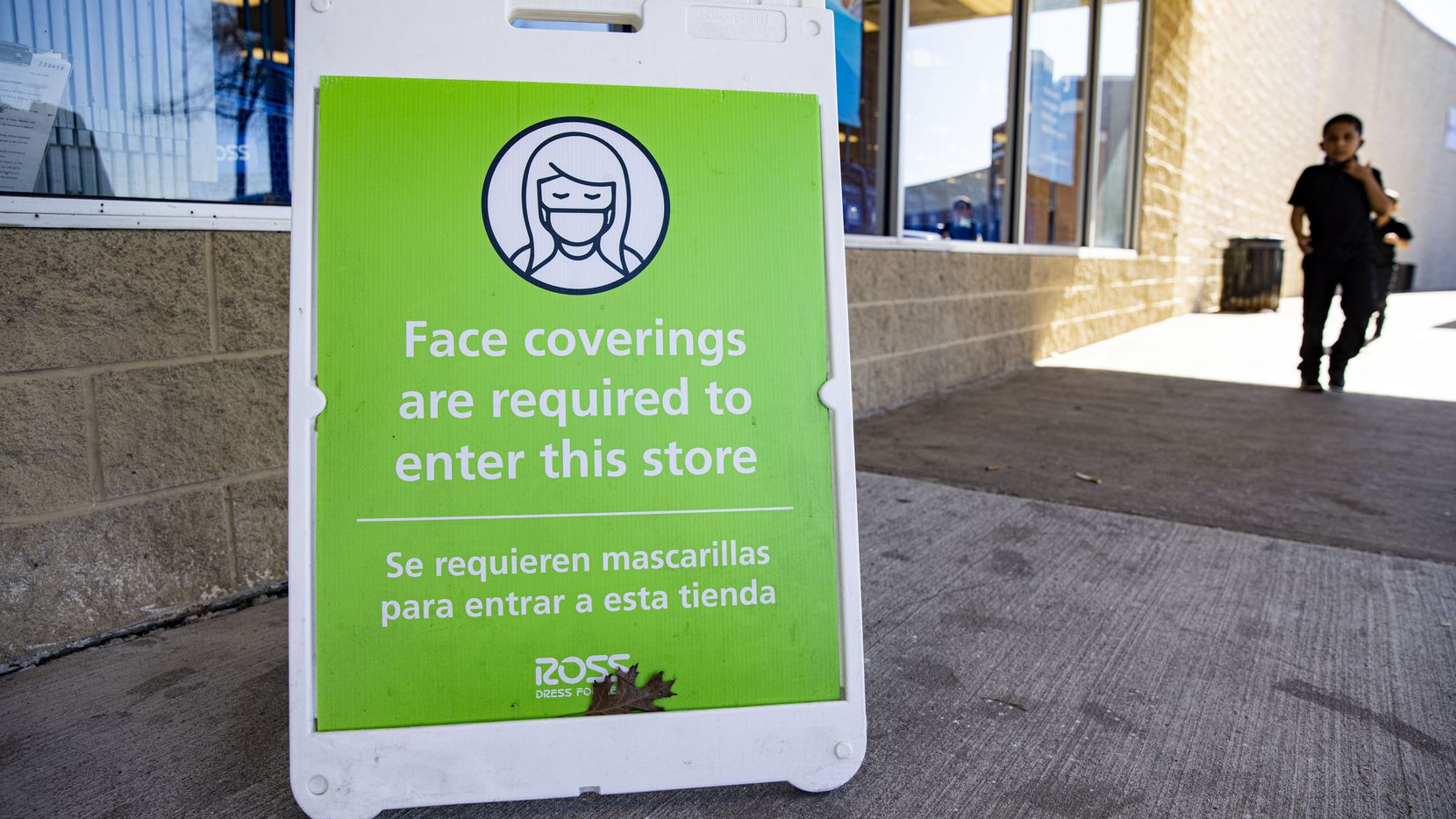 A face covering required sign at the Ross in City Place in Dallas on Tuesday, March 2, 2021. Gov. Greg Abbott announced that all business can reopen at 100 percent capacity and also ended the mask mandate starting next week. (Juan Figueroa/ The Dallas Morning News)