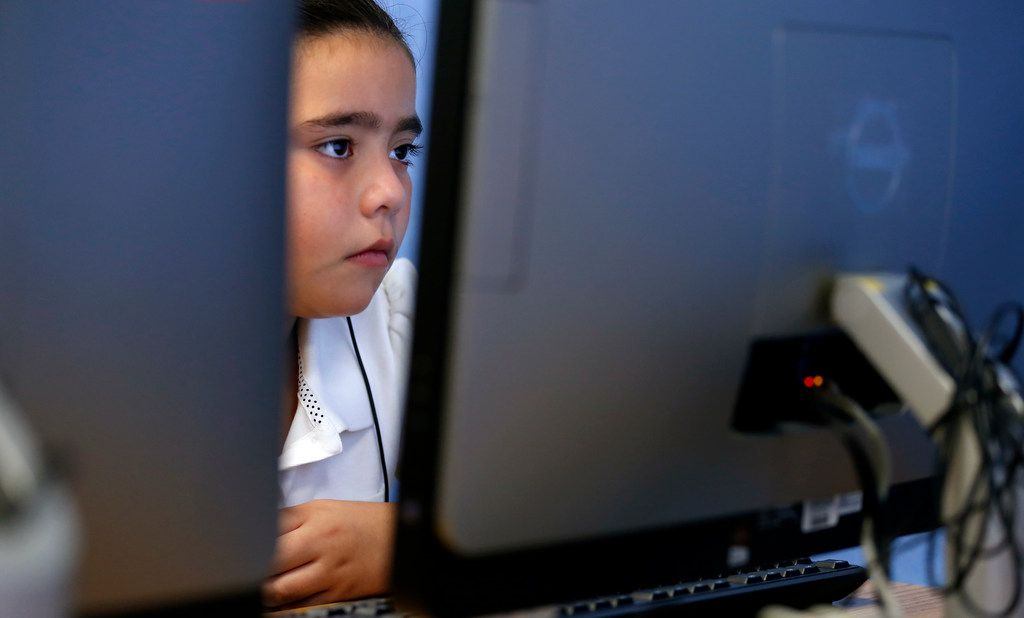 Second grader Yahaira Garcia works on a debugging lesson during a coding class at Frederick Douglass Elementary in Dallas, Thursday, Oct. 12, 2017. Dallas ISD is rapidly expanding computer science instruction to elementary schools across the district, as part of an effort between DISD and Code.org. (Jae S. Lee/The Dallas Morning News)