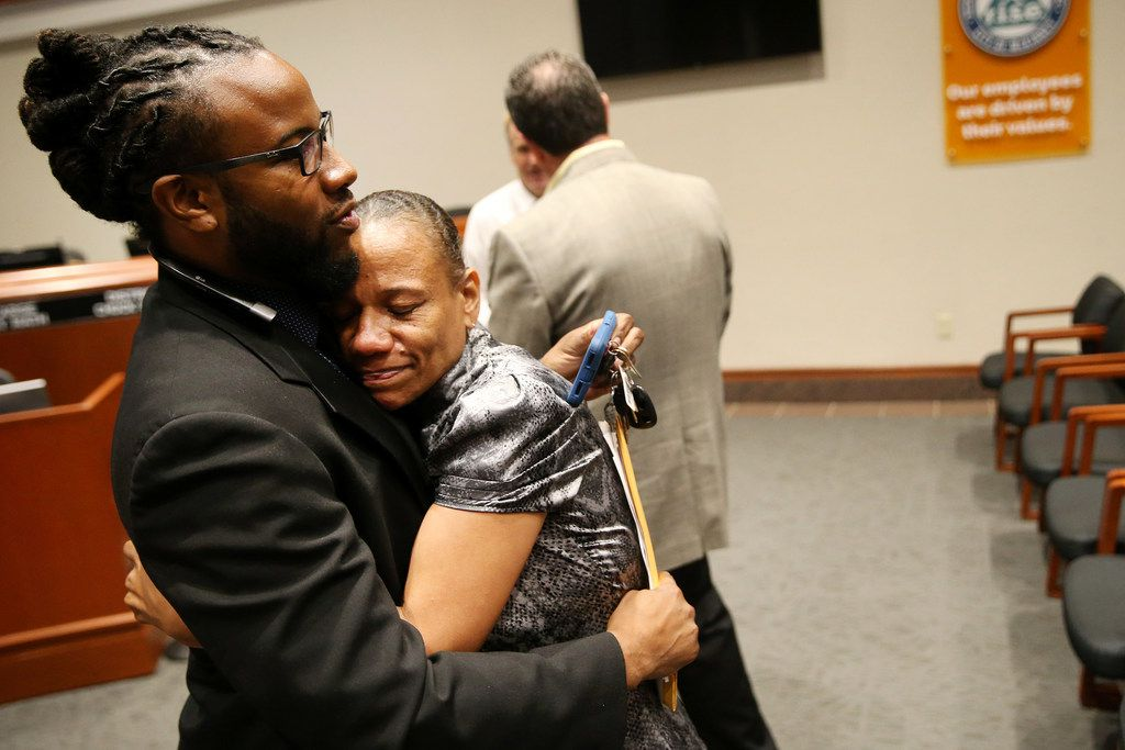 McKinney city councilman La'Shadion Shemwell hugs his mother, Rolanda Mocharia, following a special meeting of the McKinney City Council in May 2018.