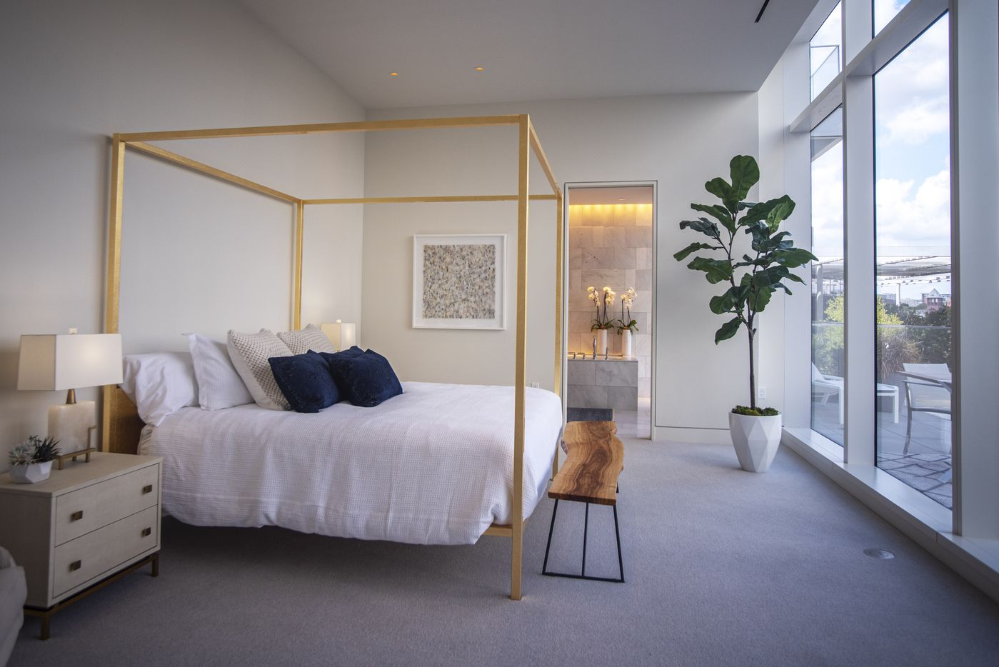 A master bedroom inside a model condo at the Hall Arts Residences.