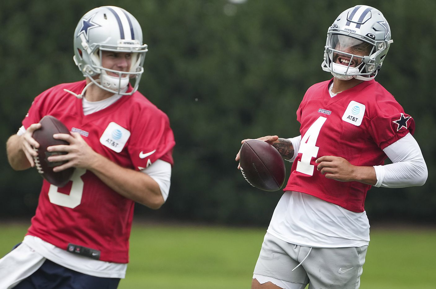 Dallas Cowboys quarterbacks Dak Prescott (4) and Garrett Gilbert (3) participate in a drill during a minicamp practice at The Star on Wednesday, June 9, 2021, in Frisco. (Smiley N. Pool/The Dallas Morning News)