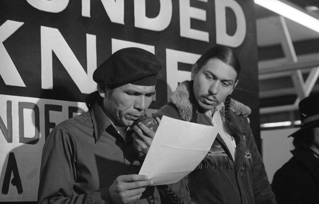 American Indian Movement leader Dennis Banks (left, with fellow leader Carter Camp) died Oct. 29. (The Associated Press)