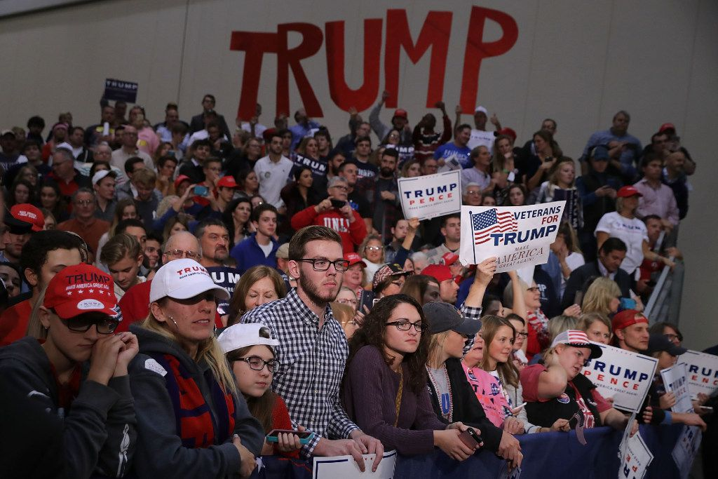 GRAND RAPIDS, MI - NOVEMBER 08:  Supporters listen to Republican presidential nominee Donald Trump during his final campaign rally on Election Day in the Devos Place November 8, 2016 in Grand Rapids, Michigan. Trump's marathon last day of campaigning stretched past midnight and into Election Day.  (Photo by Chip Somodevilla/Getty Images)