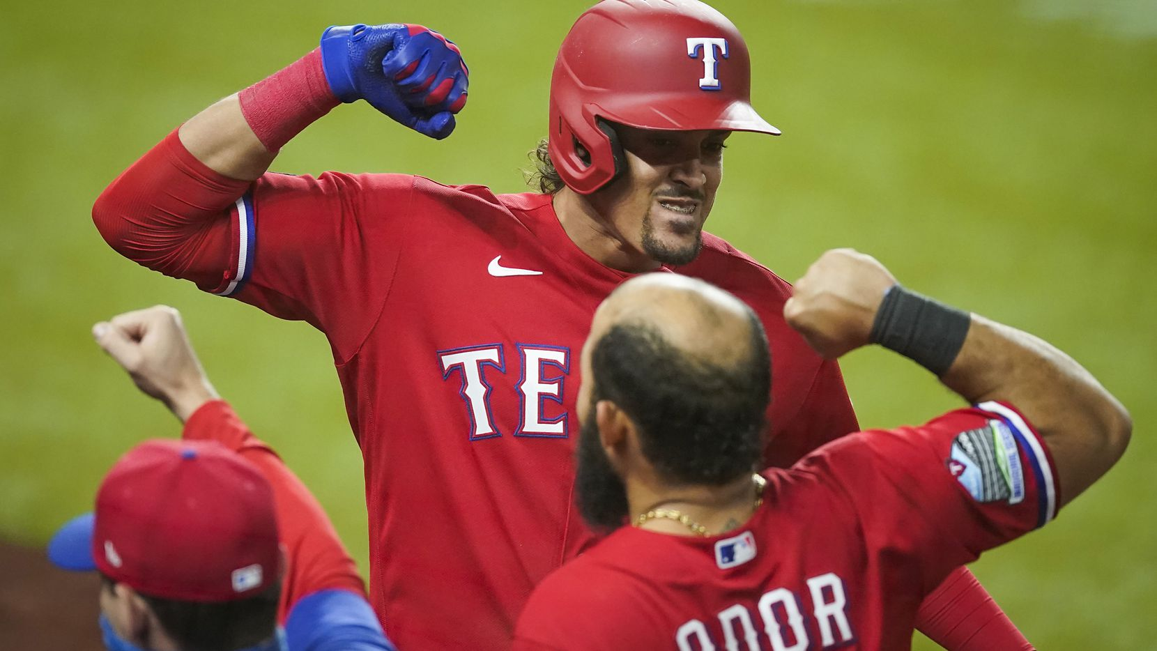 Texas Rangers first baseman Ronald Guzman celebrates with second baseman Rougned Odor after hitting a game tying solo home run during the ninth inning against the Houston Astros at Globe Life Field on Friday, Sept. 25, 2020.