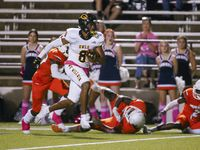 Garland's WR Ellis Rogers (8) evades the Sachse defense for a touchdown during the first quarter of a District 9-6A game between Garland and Sachse on Thursday, Oct. 14, 2021, in Garland. (Juan Figueroa/The Dallas Morning News)