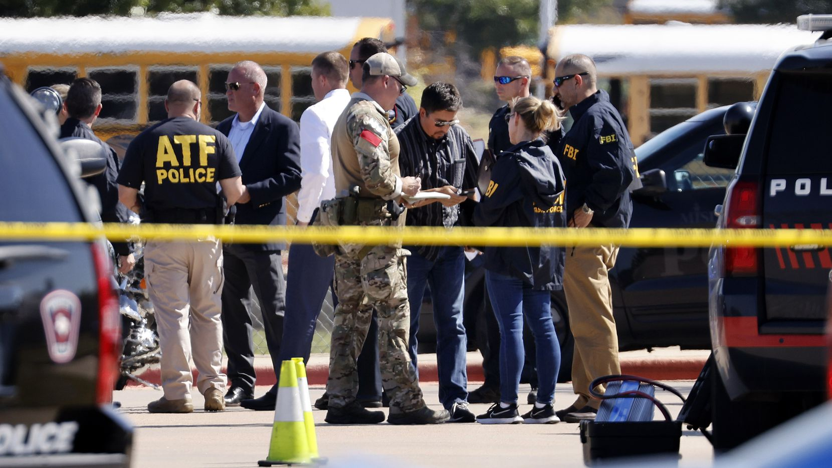 Police officials work the scene of a school shooting at Mansfield Timberview High School in Arlington, Texas, Wednesday, October 6, 2021. Four people were injured in a shooting at Timberview High School in Arlington on Wednesday morning, and authorities said the suspect remained at large. (Tom Fox/The Dallas Morning News)