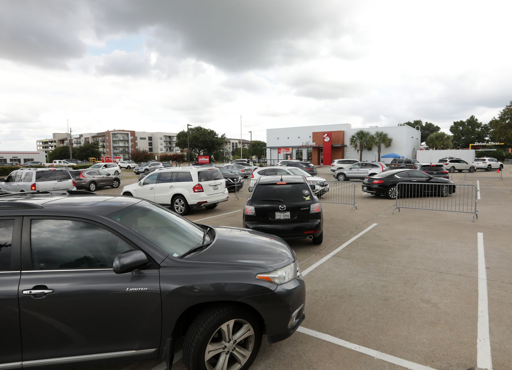 If Jollibee seems far away from this vantage point, it is: The end of the line snakes through part of the parking lot at Calloway's Nursery, then spills out onto Preston Road at peak hours.