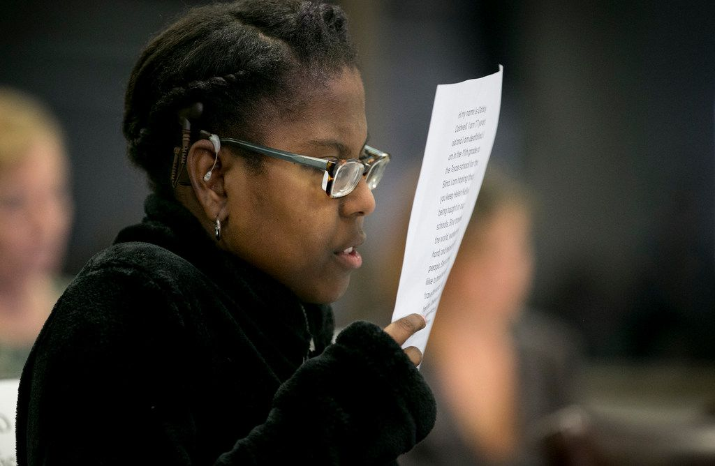 Gabby Caldwell, 17, who is deaf and blind, looks at her notes after speaking in favor of keeping Helen Keller in the Texas social studies curriculum at the State Board of Education meeting in the William B. Travis Building on Tuesday November 13, 2018.    [JAY JANNER/AMERICAN-STATESMAN]