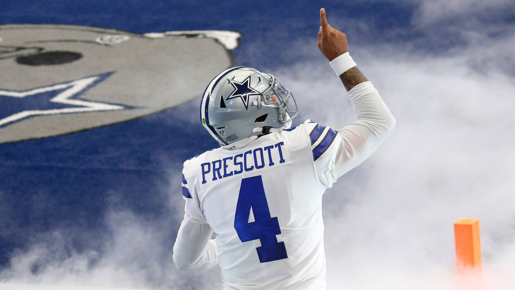 Dallas Cowboys quarterback Dak Prescott (4) points up as he takes the field during introductions before a game against the Atlanta Falcons for the home opener at AT&T Stadium in Arlington, Texas on Sunday, September 20, 2020.