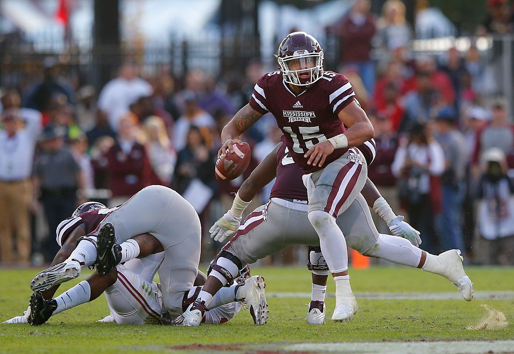 STARKVILLE, MS - NOVEMBER 14:  Dak Prescott #15 of the Mississippi State Bulldogs rushes out of the pocket against the Alabama Crimson Tide at Davis Wade Stadium on November 14, 2015 in Starkville, Mississippi.  (Photo by Kevin C. Cox/Getty Images)