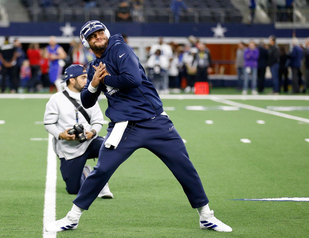 Dallas Cowboys quarterback Dak Prescott (4) stretches before a game against the Buffalo Bills at AT&T Stadium in Arlington, Texas on Thursday, November 28, 2019. (Vernon Bryant/The Dallas Morning News)