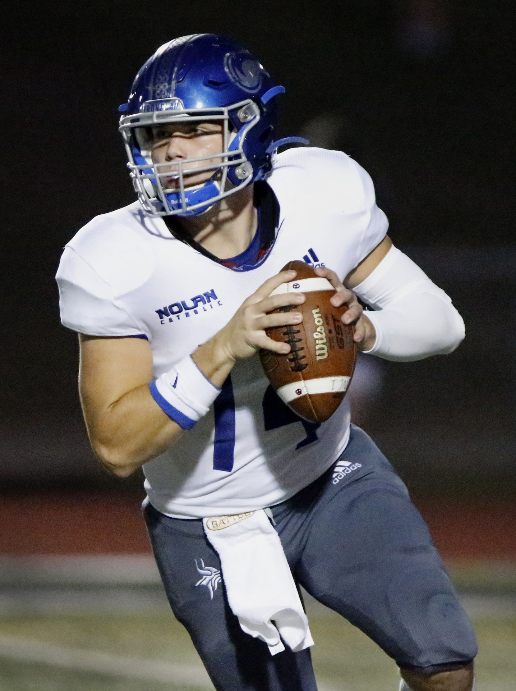 Nolan Catholic High School quarterback Jimmy Taylor (14) rolls out to pass during the first half as Prestonwood Christian Academy hosted Nolan Catholic High School at Lions Stadium in Plano on Friday night, October 9, 2020. (Stewart F. House/Special Contributor)