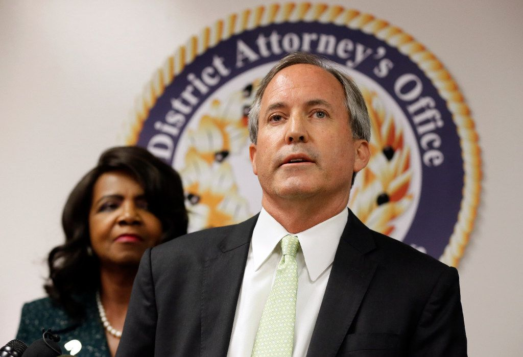 Texas Attorney General Ken Paxton speaks during a news conference on voter fraud as Dallas County District Attorney Faith Johnson looks on.