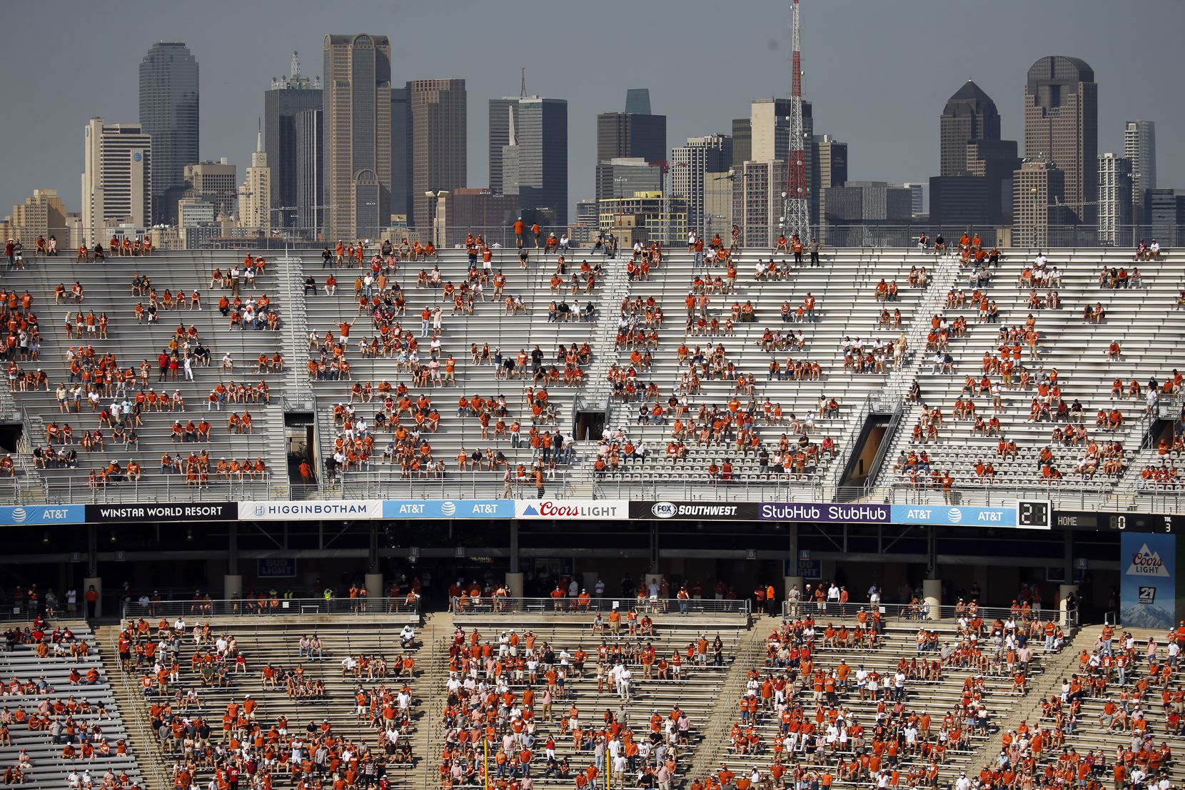 The Dallas skyline rose above socially distanced Texas fans during the first quarter of the Red River Showdown at the Cotton Bowl on Oct. 10. Oklahoma survived in quadruple overtime, 53-45.