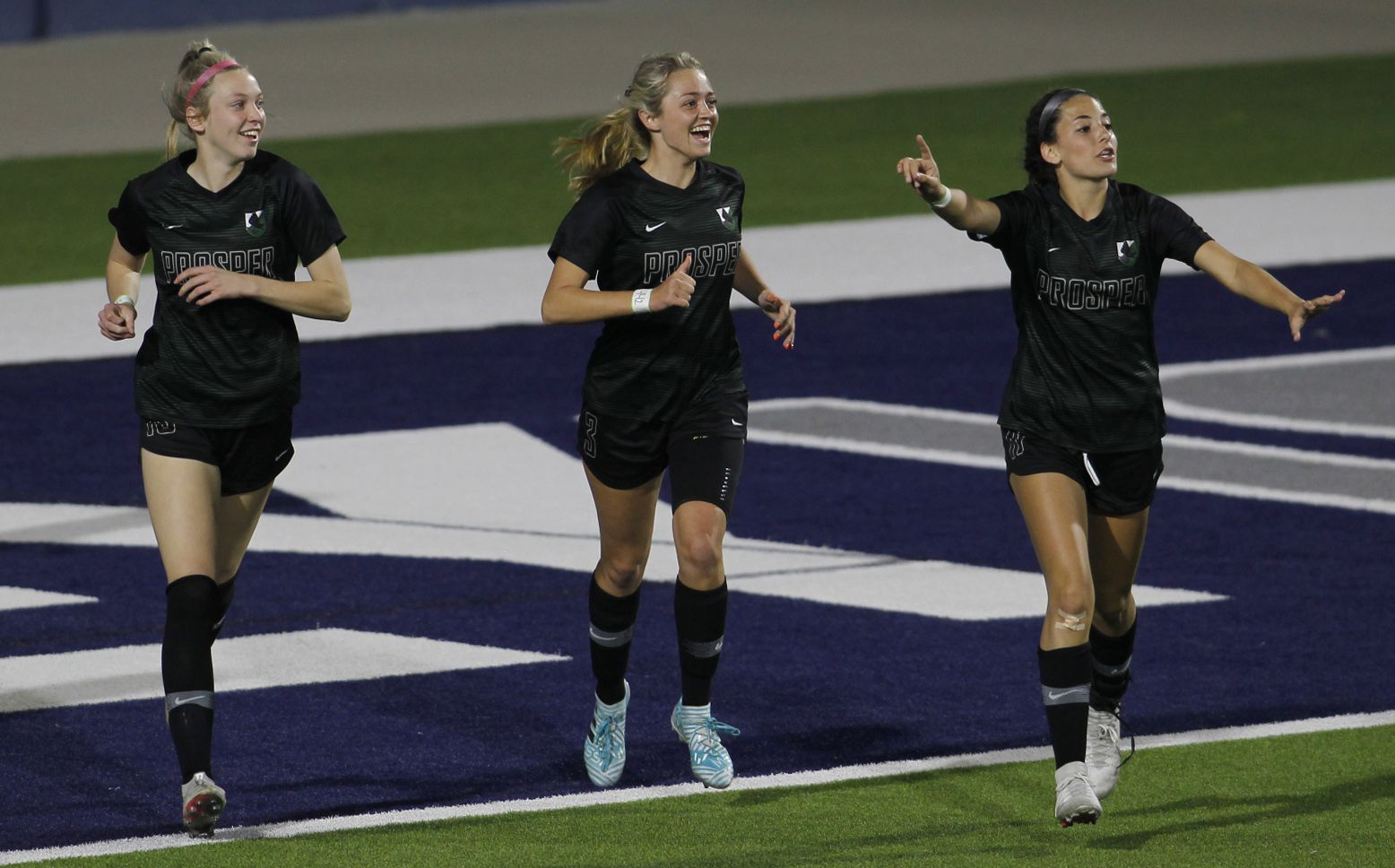 Framed by teammates Hadley Murrell (10), left, and Emma Yolinsky (11), right, Prosper forward Kaitlyn Giametta (3), center, is all smiles as the trio celebrated her goal against Coppell during first half action. The two teams played their Class 6A bi-district girls soccer playoff game at McKinney ISD Stadium in McKinney on March 26, 2021. (Steve Hamm/ Special Contributor)