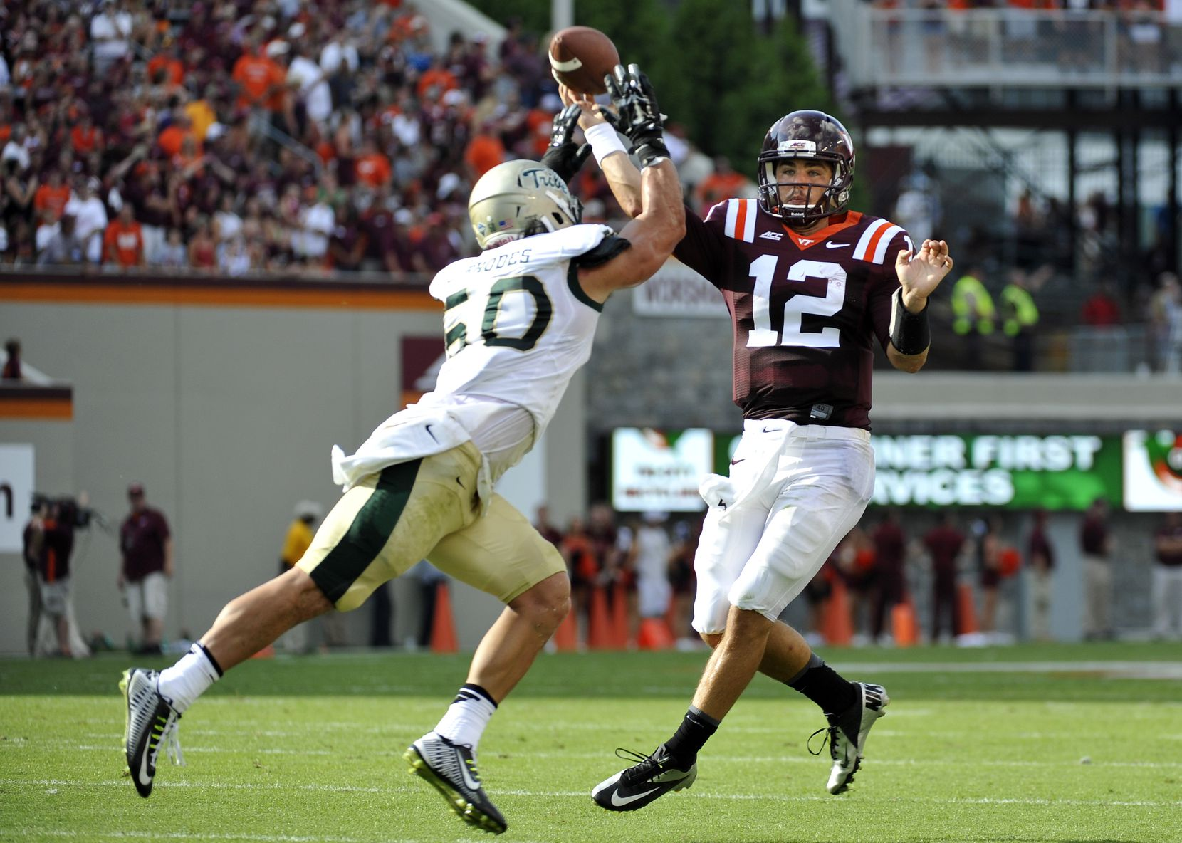 Quarterback Michael Brewer #12 of the Virginia Tech Hokies throws a pass over linebacker Luke Rhodes #50 of the William & Mary Tribe at Lane Stadium on August 30, 2014 in Blacksburg, Virginia. Virginia Tech defeated William & Mary 34-9.  (Photo by Michael Shroyer/Getty Images)
