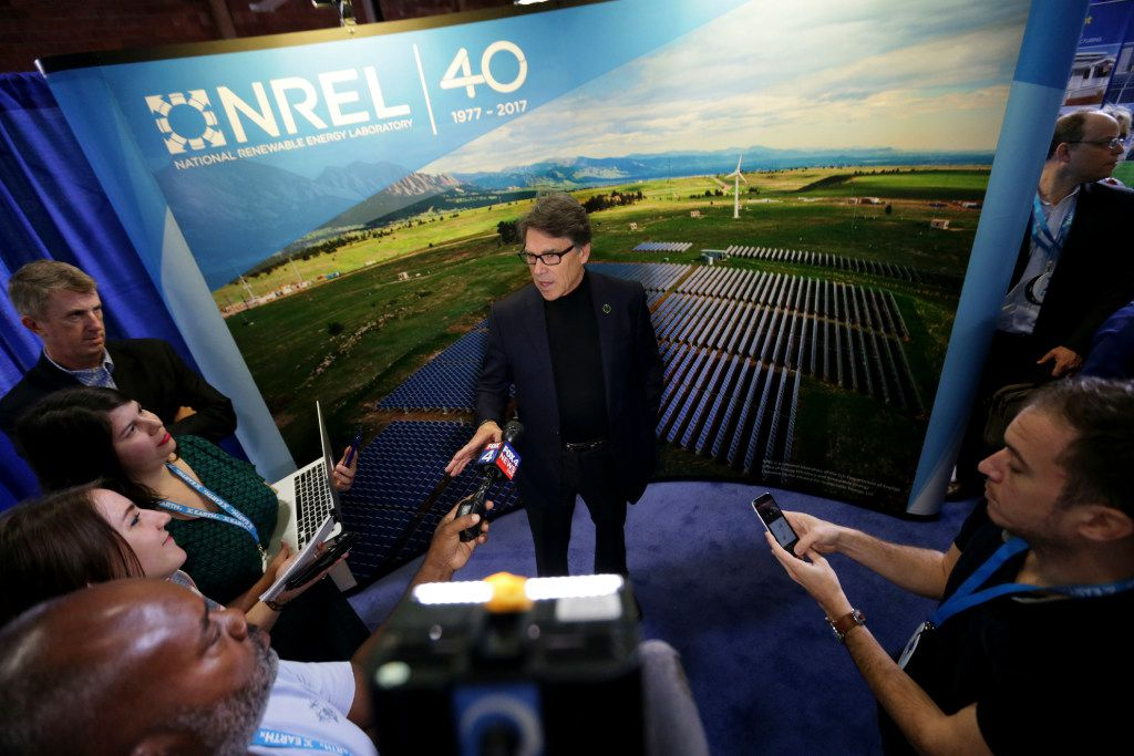 In this April 21, 2017 file photo, Energy Rick Perry speaks to reporters at an Earth Day display at Fair Park in Dallas. Since becoming President Donald Trump's energy secretary, Perry has kept a low profile and rarely has been seen publicly around Washington.