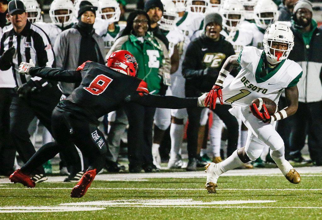 DeSoto wide receiver Jordan Brown works to break free from Cedar Hill linebacker Stefan Ingram (8) during a high school football match up between Cedar Hill and DeSoto on Thursday, Nov. 7, 2019. (Ryan Michalesko/The Dallas Morning News)