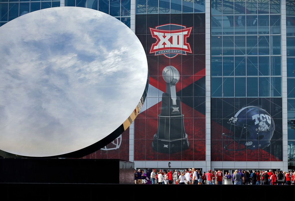 The Big XII Championship logo appears behind the Sky Mirror sculpture outside AT&T Stadium before the Oklahoma Sooners face the TCU Horned Frogs in Arlington, Texas, Saturday, December 2, 2017. (Tom Fox/The Dallas Morning News)