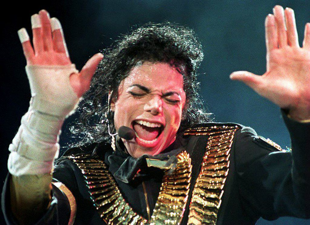 """In this file photo taken on Aug. 31, 1993, Michael Jackson performs during his """"Dangerous"""" tour in Singapore."""